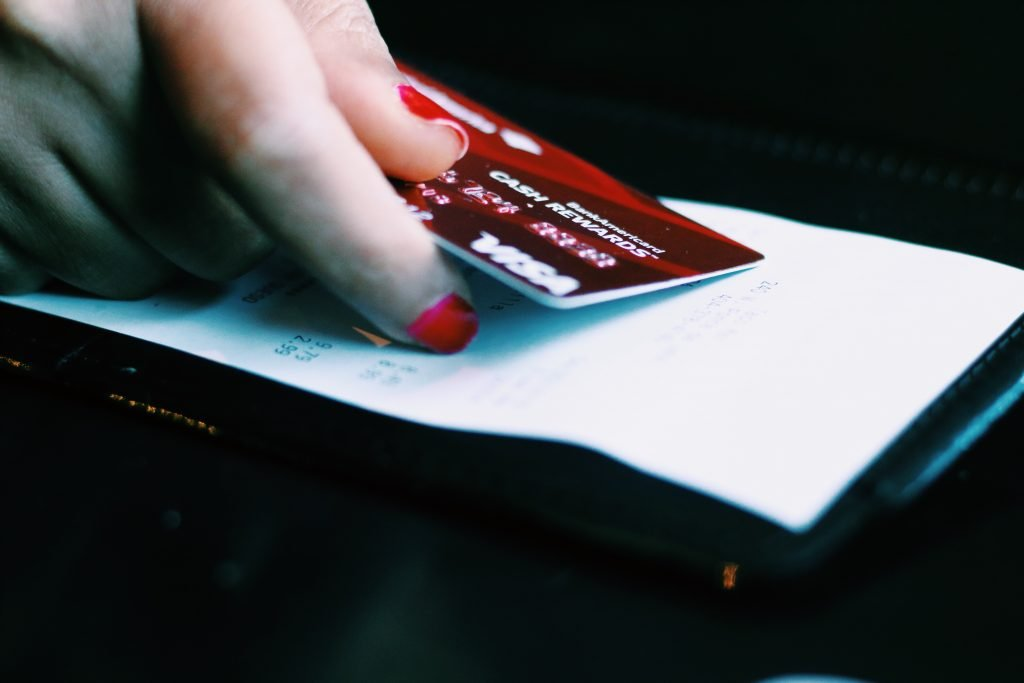Customer paying with Visa at a restaurant