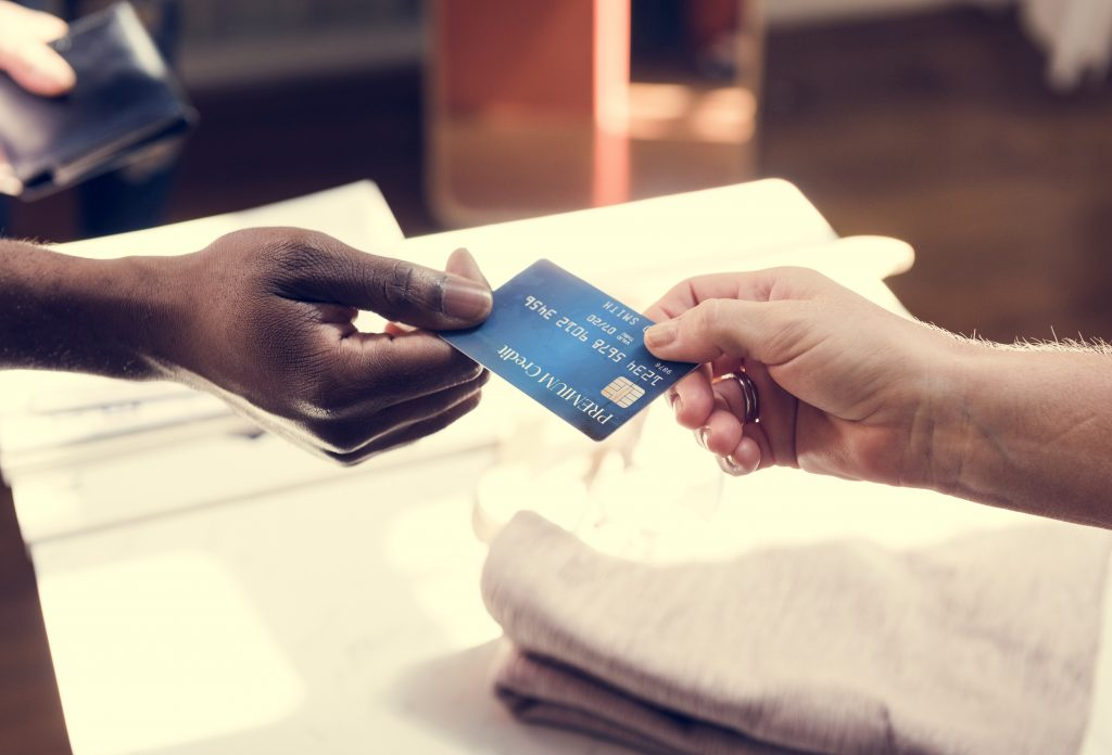 Customer handing off credit card for payment