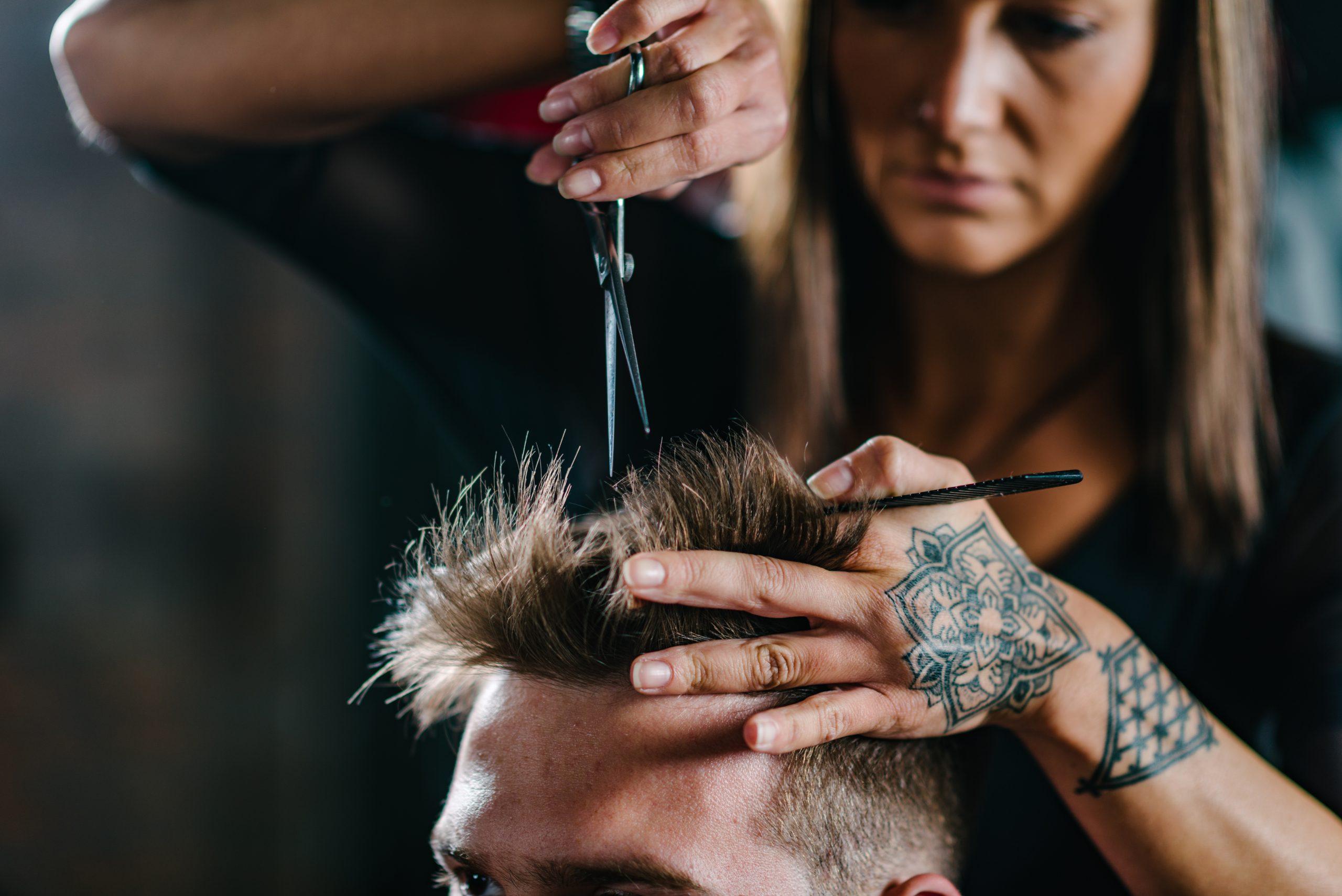 Person getting a haircut in a salon