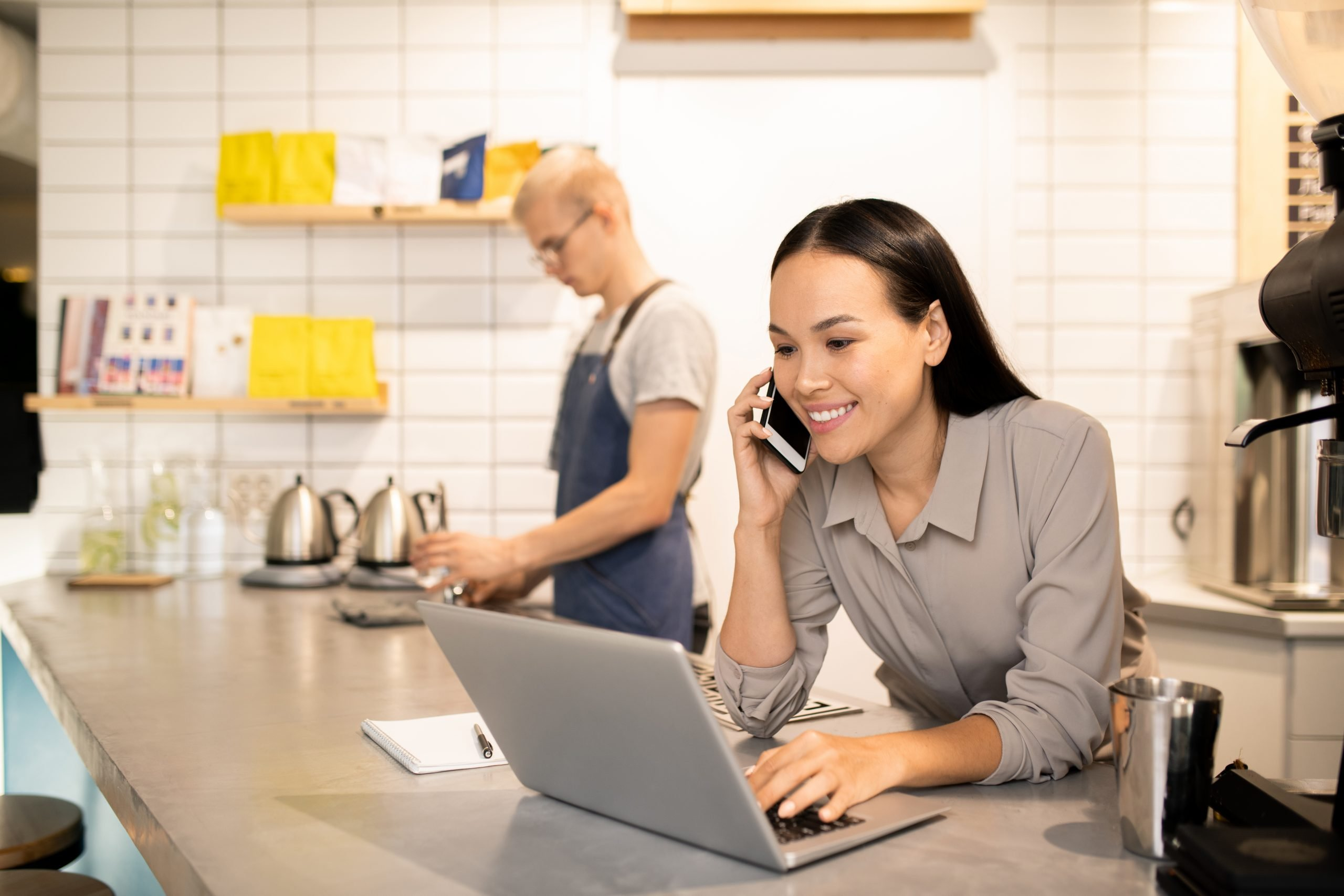 Manager of restaurant setting up payment processing